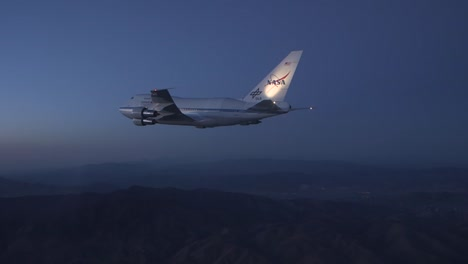 Nasa-747-Specially-Fitted-To-Carry-Space-Shuttle-In-Flight-At-Dusk-And-Night