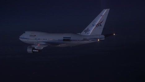 Nasa-747-Specially-Fitted-To-Carry-Space-Shuttle-In-Flight-At-Dusk-And-Night-1
