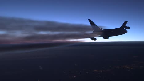 A-Generic-Airplane-In-Flight-At-Sunset-With-Contrail