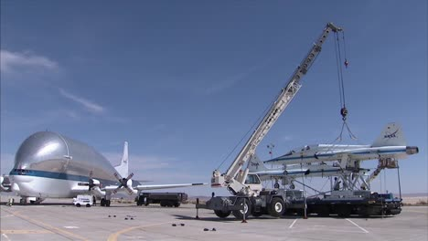 Two-T38-Jet-Planes-Are-Retired-By-Being-Placed-Inside-A-Super-Guppy-Transport-Plane-At-Dryden-Air-Force-Base