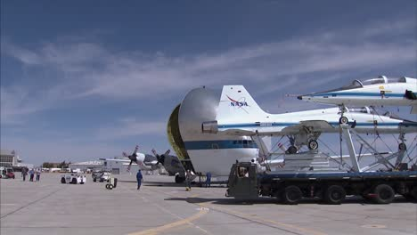 Two-T38-Jet-Planes-Are-Retired-By-Being-Placed-Inside-A-Super-Guppy-Transport-Plane-At-Dryden-Air-Force-Base-2