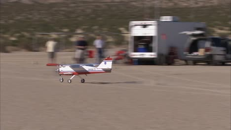 A-Small-Drone-Airplane-Lands-In-The-Desert