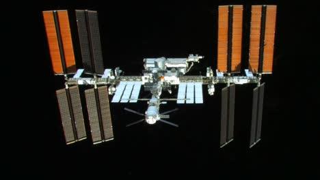 The-International-Espacio-Station-Flies-Against-A-Black-Background