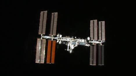The-International-Space-Station-Flies-Against-A-Black-Background-1