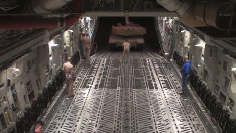 Fast-Motion-Shot-As-Airmen-Prepare-Secure-And-Transport-A-Usmc-M1A1-Abrams-Tank-To-Afghanistan-Aboard-A-C17-Globemaster
