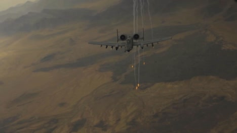 An-A10-Warthog-Release-Flares-At-A-High-Altitude-Then-Peels-Away