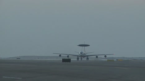 A-Us-Air-Force-E3-Sentry-Awacs-Plane-Lands-And-Taxis-On-A-Runway