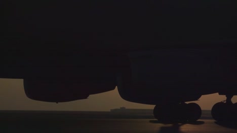 An-Air-Force-Kc10-Taxis-Against-The-Sun-On-The-Tarmac-Of-A-Military-Base