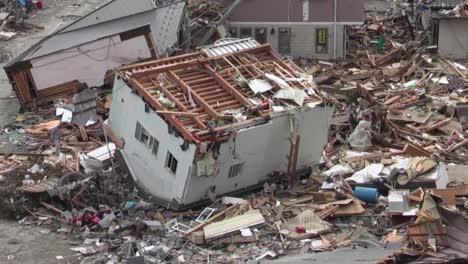 Search-And-Rescue-Teams-Hunt-For-Survivors-Following-The-Devastating-Earthquake-And-Tsunami-In-Japan-In-2012
