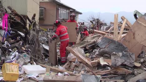 Search-And-Rescue-Teams-Hunt-For-Survivors-Following-The-Devastating-Earthquake-And-Tsunami-In-Japan-In-2015