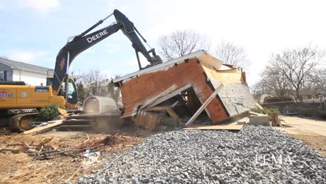 A-Suburban-Home-Is-Torn-Down-1