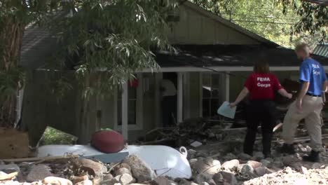 Fema-Relief-And-Aid-Workers-Interview-Homeowners-Following-A-Disastrous-Flood-1