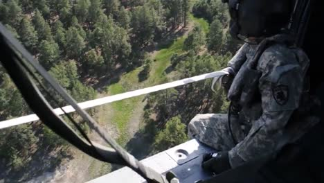 Pov-From-A-Water-Dropping-Helicopter-Flying-Over-A-Fire
