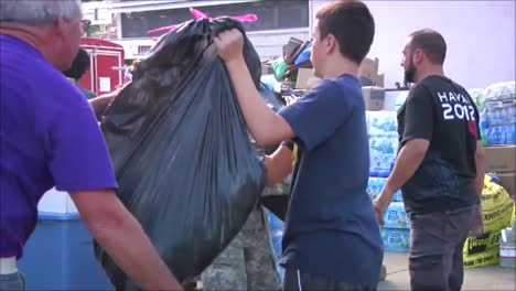 National-Guard-Army-Troops-Distribute-Food-And-Relief-Aid-To-People-After-A-Devastating-Forest-Fire