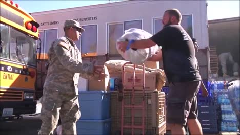 National-Guard-Army-Troops-Distribute-Food-And-Relief-Aid-To-People-After-A-Devastating-Forest-Fire-1