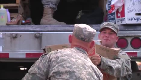 National-Guard-Army-Troops-Distribute-Food-And-Relief-Aid-To-People-After-A-Devastating-Forest-Fire-2