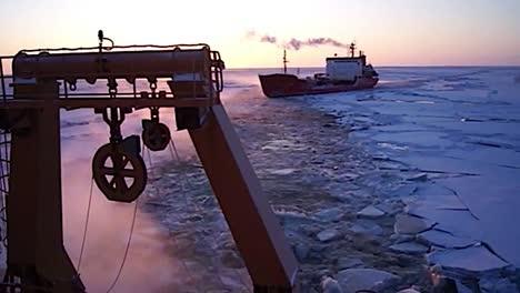 A-Coast-Guard-Icebreaker-Ship-Cuts-A-Path-Through-Arctic-Ice-For-A-Cargo-Vessel