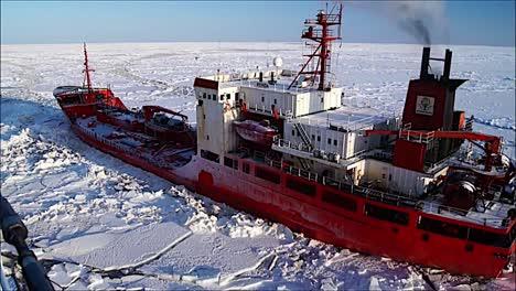 A-Coast-Guard-Icebreaker-Ship-Cuts-A-Path-Through-Arctic-Ice-For-A-Cargo-Vessel-1
