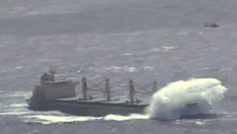 News-Footage-Of-The-Coast-Guard-Flying-Above-A-Cargo-Ship-On-The-High-Seas-And-Rescuing-Or-Airlifting-A-Crewman
