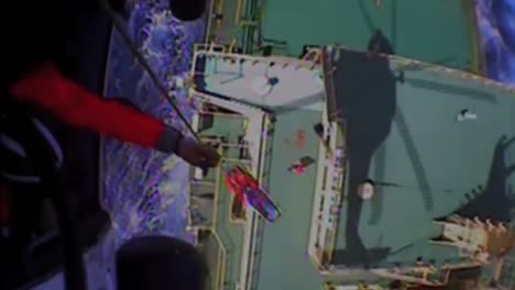 News-Footage-Of-The-Coast-Guard-Flying-Above-A-Cargo-Ship-On-The-High-Seas-And-Rescuing-Or-Airlifting-A-Crewman-1