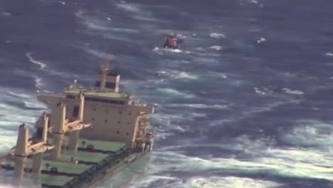 News-Footage-Of-The-Coast-Guard-Flying-Above-A-Cargo-Ship-On-The-High-Seas-And-Rescuing-Or-Airlifting-A-Crewman-3