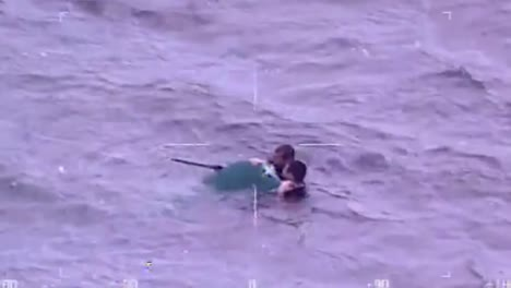 The-Coast-Guard-Rescues-Two-Men-From-A-Capsized-Canoe