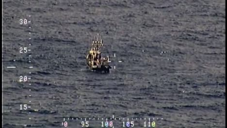 A-Dramatic-High-Seas-Rescue-By-The-Coast-Guard-Of-Passengers-From-A-Burning-Ship-1