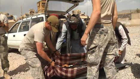 Members-Of-The-Us-Army-And-Air-Force-Help-Evacuate-An-Afghan-Child-That-Was-Injured-In-An-Ied-Attack