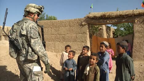 Soldiers-On-Patrol-In-Zabul-Province-Afghanistan-Shake-Hands-With-Villagers-And-Take-Prisoners-1