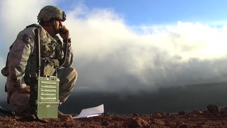 A-Soldier-Uses-A-Mobile-Radio-To-Communicate-During-A-Battle