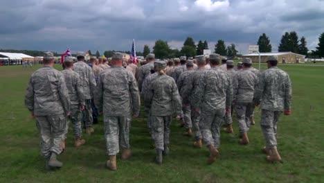 American-Troops-March-On-A-Field-In-Germany