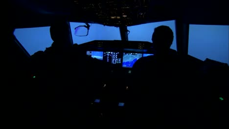 Interior-Of-An-Airplane-Cockpit-As-Pilots-Try-To-Navigate-Through-A-Storm