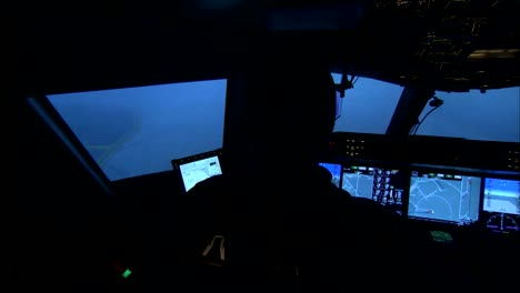 Interior-Of-An-Airplane-Cockpit-As-Pilots-Taxi-On-A-Runway-In-A-Storm