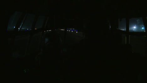 An-Airplane-Takes-Off-From-A-Runway-At-Night-From-The-Cockpit