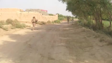 Soldiers-On-Foot-Patrol-In-Afghanistan-Encounter-Villagers-And-Children