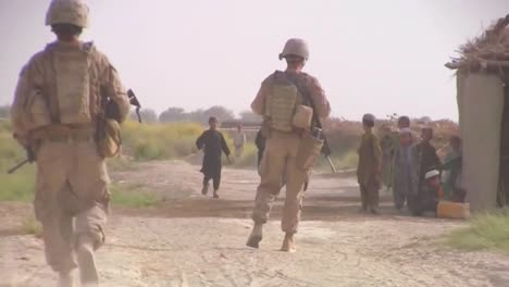 Soldiers-On-Foot-Patrol-In-Afghanistan-Encounter-Villagers-And-Children-1
