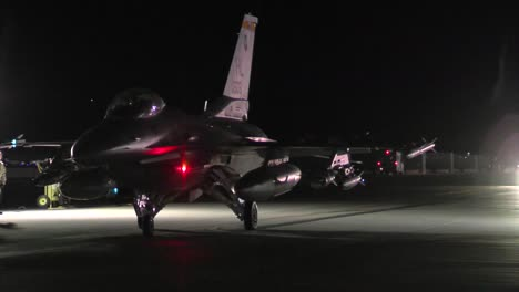 A-F16-Fighter-Jet-Taxis-On-A-Runway-At-Night-1