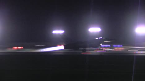 A-F16-Fighter-Jet-Taxis-On-A-Runway-At-Night-4
