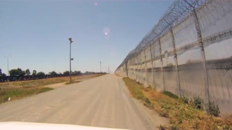 Pov-Shot-As-A-Border-Patrol-Vehicle-Moves-Along-A-Dirt-Road-On-The-Us-Mexican-Border