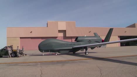 A-Rq4-Surveillance-Drone-Is-Rolled-Out-Onto-A-Runway-By-Military-Personnel