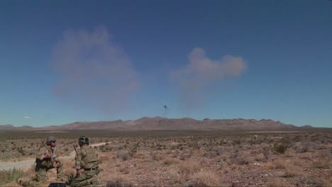 An-F35-Lightning-Bombs-Targets-In-The-Desert-While-Soldiers-Look-On-1