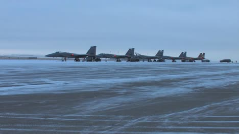 F15-Jet-Fighters-Prepare-For-A-Mission-On-A-Snowy-Morning-In-Montana