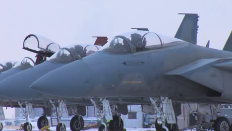 F15-Jet-Fighters-Prepare-For-A-Mission-On-A-Snowy-Morning-In-Montana-1