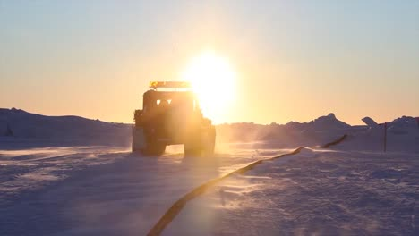 A-Tundra-Buggy-Drives-Across-An-Ice-Floe-To-Approach-A-Ship