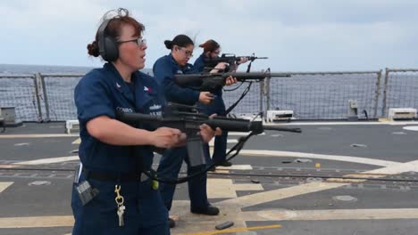 Navy-Women-Conduct-Live-Fire-Exercise-On-The-Deck-Of-A-Warship
