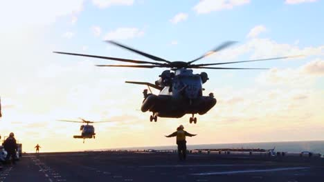 Helicopters-Land-On-The-Deck-Of-An-Aircraft-Carrier-During-Search-And-Rescue-Operations-Of-Hurricane-Sandy