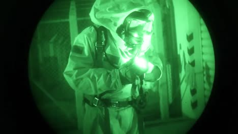Night-Vision-Of-Men-In-Biohazard-Suits-Entering-An-Industrial-Area-And-Searching-For-Chemical-Leaks-1