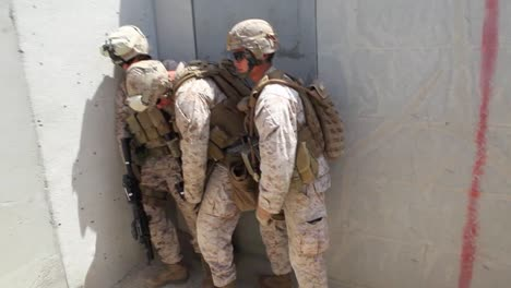 Us-Marines-And-Navy-Seals-Conduct-A-Raid-Of-A-Simulated-Terrorist-Compound