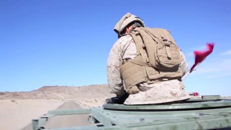 Us-Marines-And-Navy-Seals-Drive-On-Patrol-Through-A-Simulated-Arab-Village