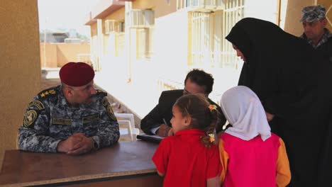 Us-Soldiers-Hand-Out-Water-Filters-Toys-And-School-Supplies-To-People-In-Baghdad-Iraq-1